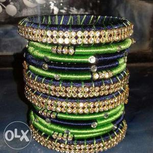 Blue and green colour thread bangles.