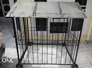 A cage[pinjra] available for all big sized dogs