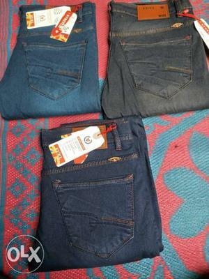Blue Denim Jeans And Red Denim Shorts