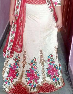 Cream with red colour heavy embroidery lengha