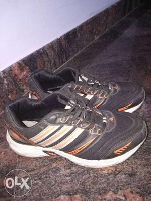 Black and white sports shoes in good condition