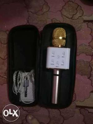 White And Gold-colored Bluetooth Microphone
