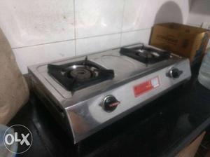 Gray 2-burner Surya stainless steel gas stove.
