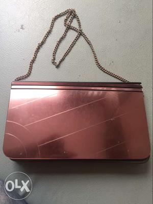 Sling purse with chain.. stylish and ok