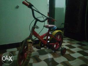 Toddler's Red Bike With Training Wheels