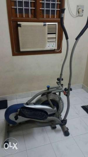 Grey, Black, And Blue Elliptical Trainer And Whit