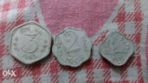 Three Silver-colored 1, 2, And 3 Indian Paise Coins