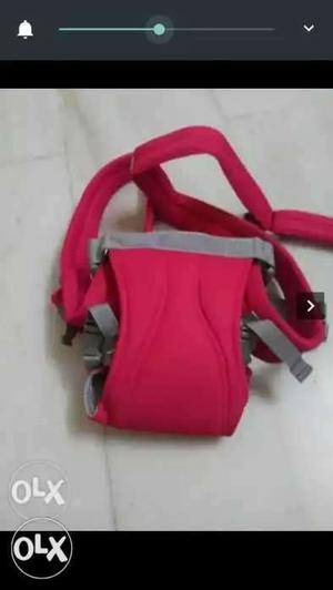 Red colour baby carrier