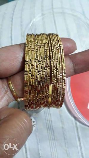 Set of 24 bangles. 1 gram gold.