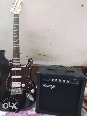 Black And Brown Stratocaster Electric Guitar And Black