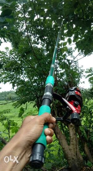 Green And Black Fishing Rod With Red Reel fexid price