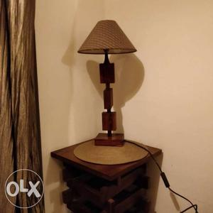 Wooden table lamp with shade both from Fab India