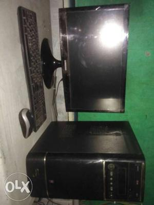 Black Flat Screen Computer Monitor; Black Computer Tower;