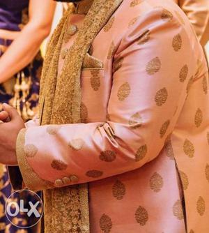Blush pink-Gold Sherwani from the brand Manyavar.