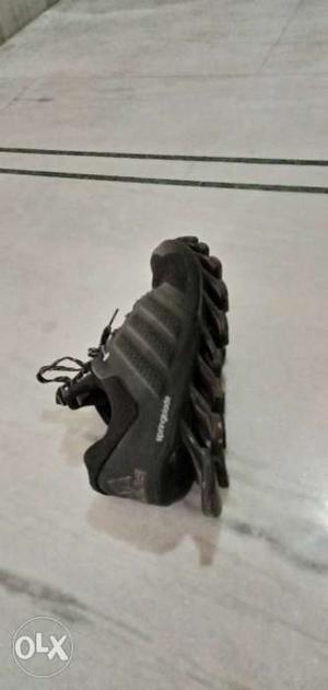 Unpaired Black Nike Air Max Shoe
