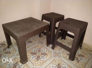 A set of fiber plastic table with 2 stools in