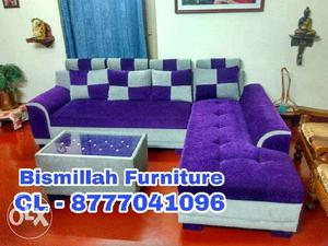 Purple and white sectional couch with pillow