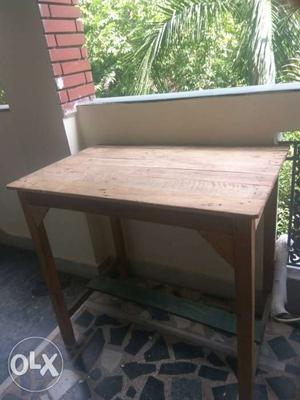 A wooden table in good condition. Less than 1 year.