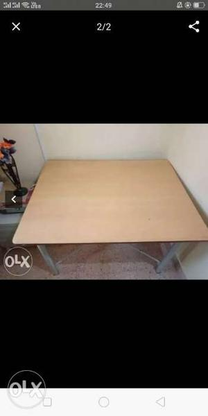 Brown Wooden Table With White Metal Base