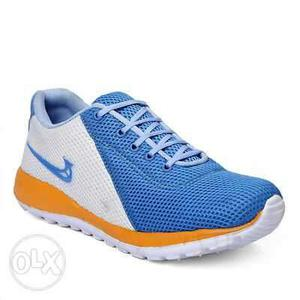 Paired Blue And Yellow Nike Running Shoe