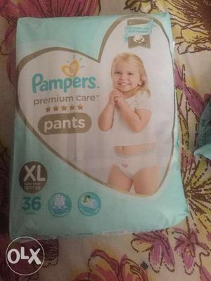 Unopened diaper packet. No more needed for my