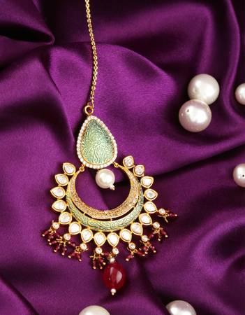 Check out the Stylish american diamond maang tikka online.